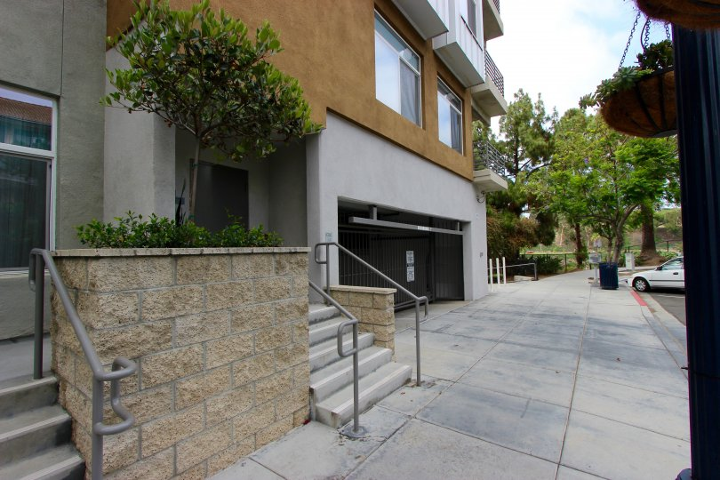 A plain sidewalk near a building in The Mills at Cortez Hill neighborhood