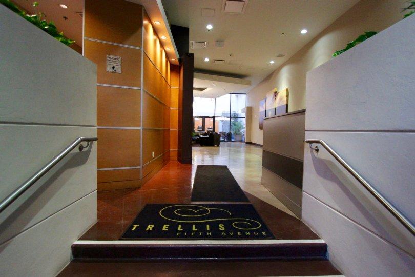 An illuminated interior of Trellis building in San Diego, California