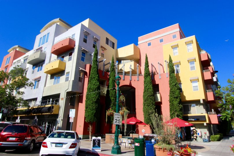A sunny day in Downtown San Diego California. An apartment building with shops in the Village Walk Community