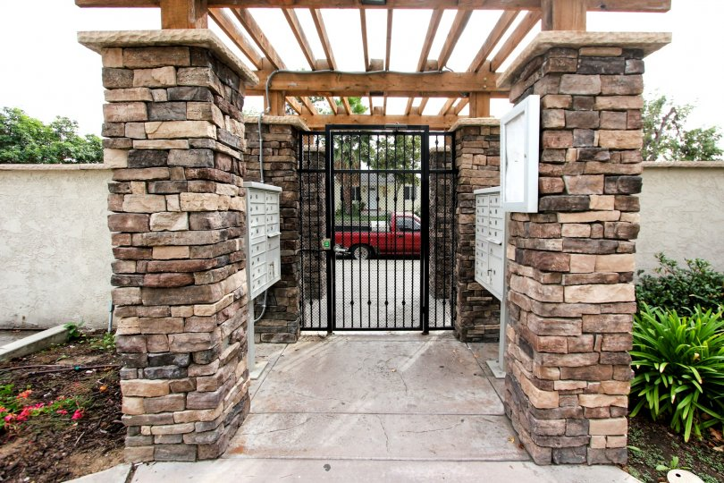 Black iron gate at arbors of Oakdale in El Cajon California