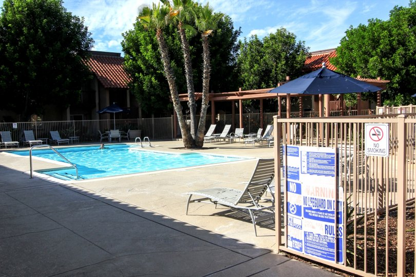 A sunny day at the pool of the Artesia housing community