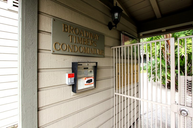 A close up shot of the front office intercom and gate of the Broadway Timbers in El Cajon, California.