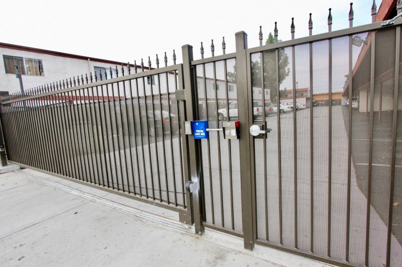 Black iron security gate at Cherrywood Park in El Cajon California