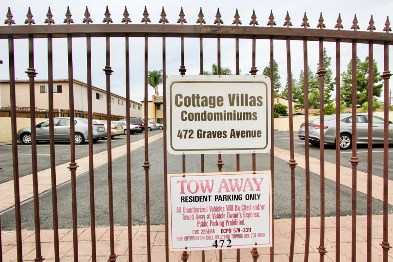 An iron gate to the parking lot at the Cottage Villas housing community