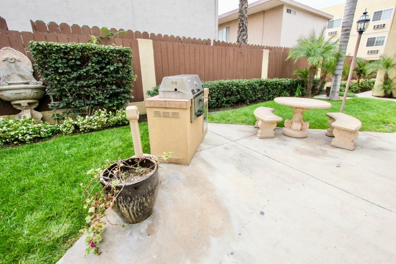 table, bench, grill, patio, fence, house, home, palm tree