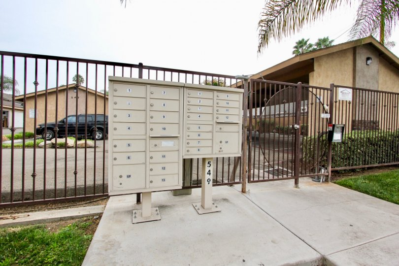 Mail boxes near security fence at El Palacio in El Cajon California