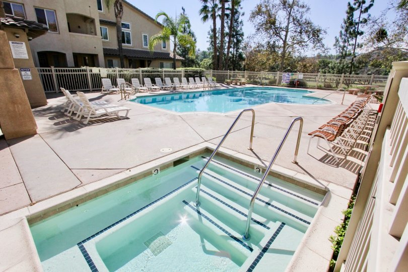 Swimming pool and lounge area of Fairwa Villas, a residential community located in El Cajon, CA