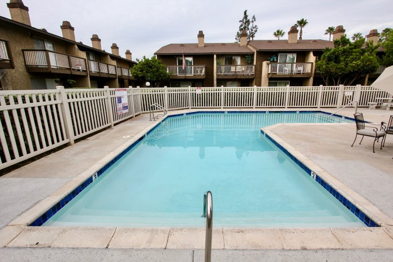 An apartment complex with a swimming pool on an overcast day in Heritage Grove, a neighborhood in El Cajon, California