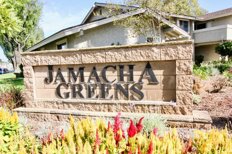 A view of Jamacha Greens Apartments Sign in El Cajon, California on a clear sunny day.