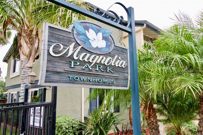 A sign indicating the Magnolia Park Townhomes, a residential community located in El Cajon, CA