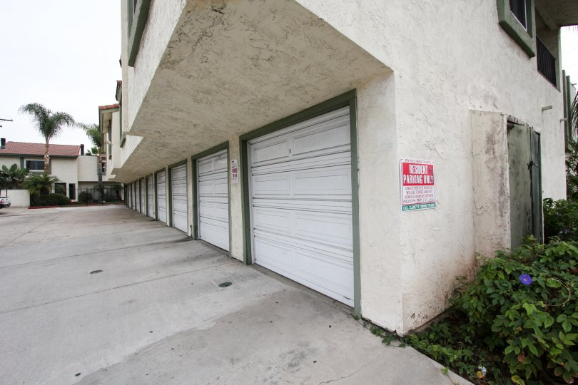 A red and white resident only parking sign on a garage in Mark Manor at El Cajon CA