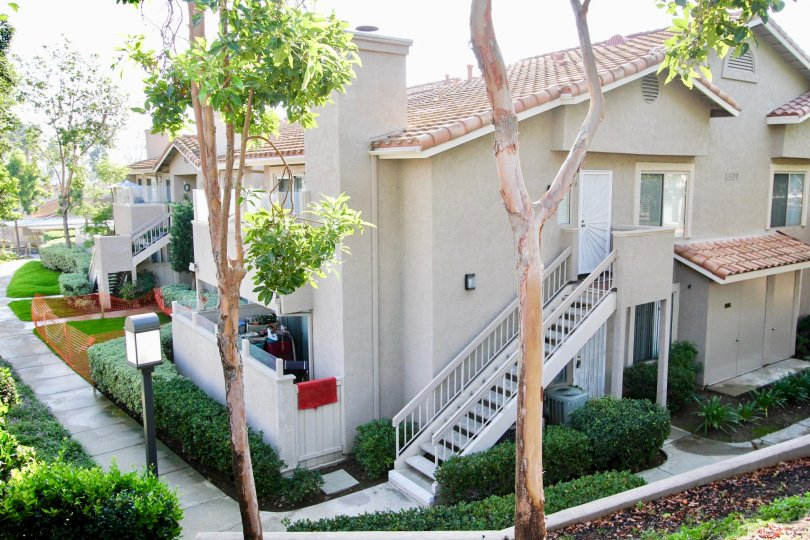 Two story residential building with attached stairway at Mirasol in El Cajon California