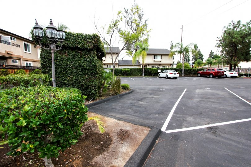 Parking lot near residential buildings at Mollison Villas II in El Cajon California
