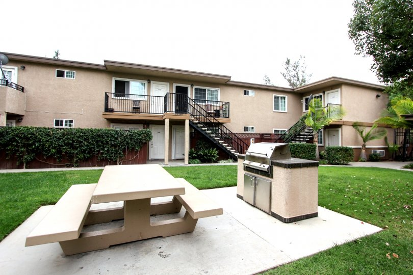 Picnic bench and barbeque at housing community Mollison Villas II in El Cajon, California