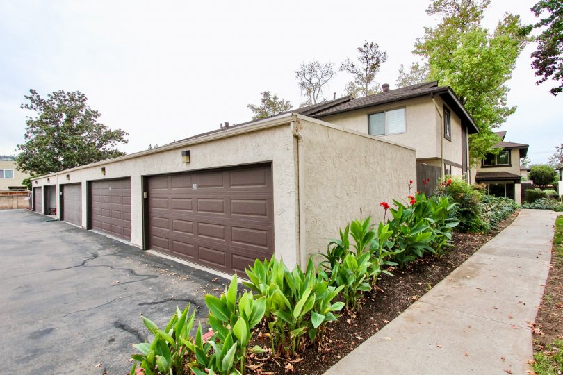 Garages behind residential units at Mollison Villas in El Cajon California