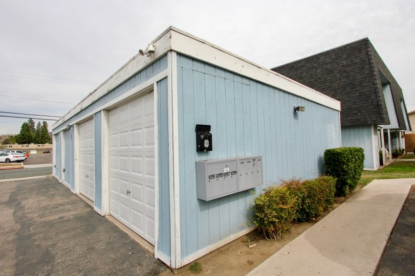 A blue garage on an overcast day in Hermosa Villas, a neighborhood in El Cajon, California