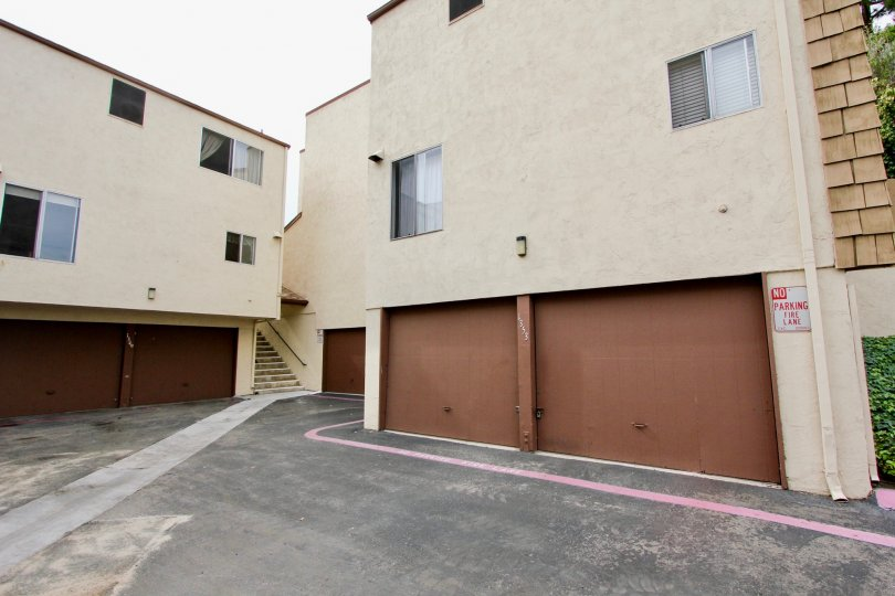 Partridge Village in El Cajon, California features 2 car garages below the units.