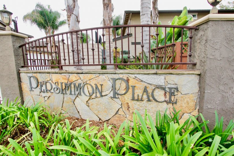 The sign at the entrance of the Persimmon Place housing community