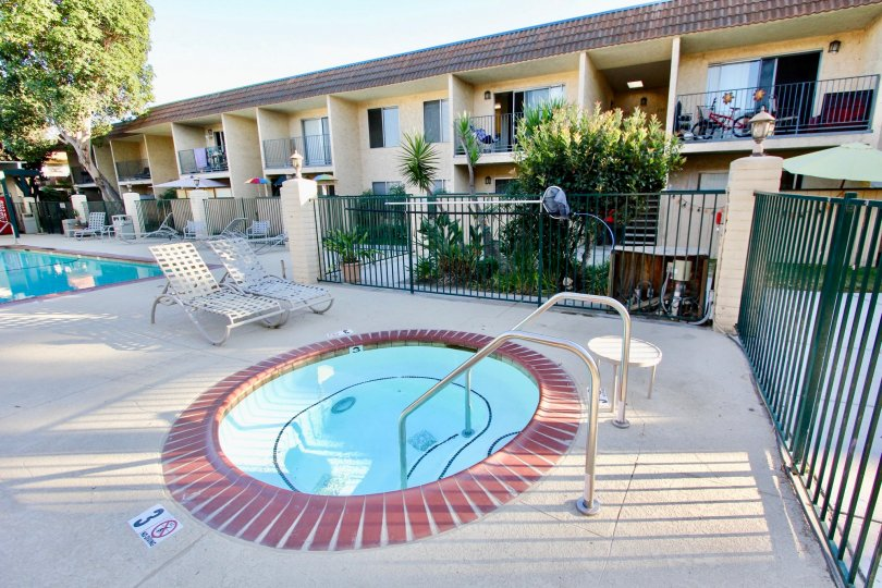 A sunny day in Sunterra has children' pool and adults pool with chairs