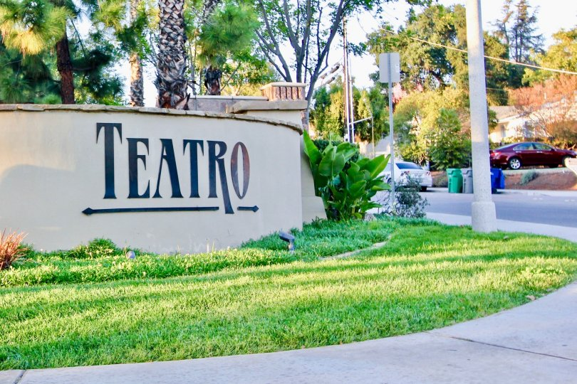 Community sign surrounded by trees at Teatro in El Cajon California