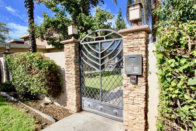 Security gate with lights at Tres Palmas in El Cajon California