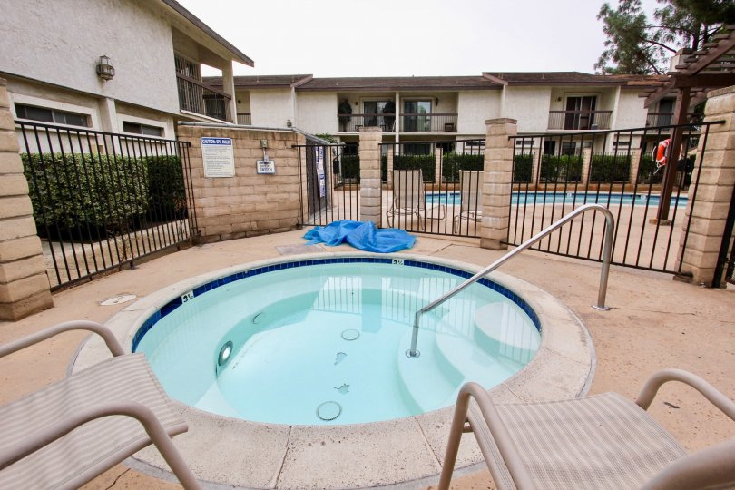 A view of a luscious gated Jacuzzi available to residents in Villa Madera in El Cajon