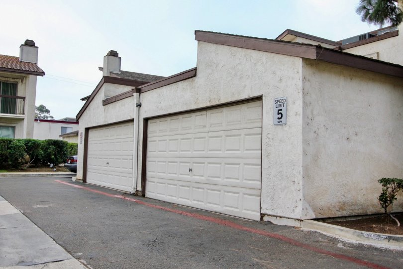 Garages in alleyway at Villa Madera in El Cajon California