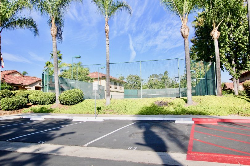 Tennis court near residential units at Villa Montevina in El Cajon California