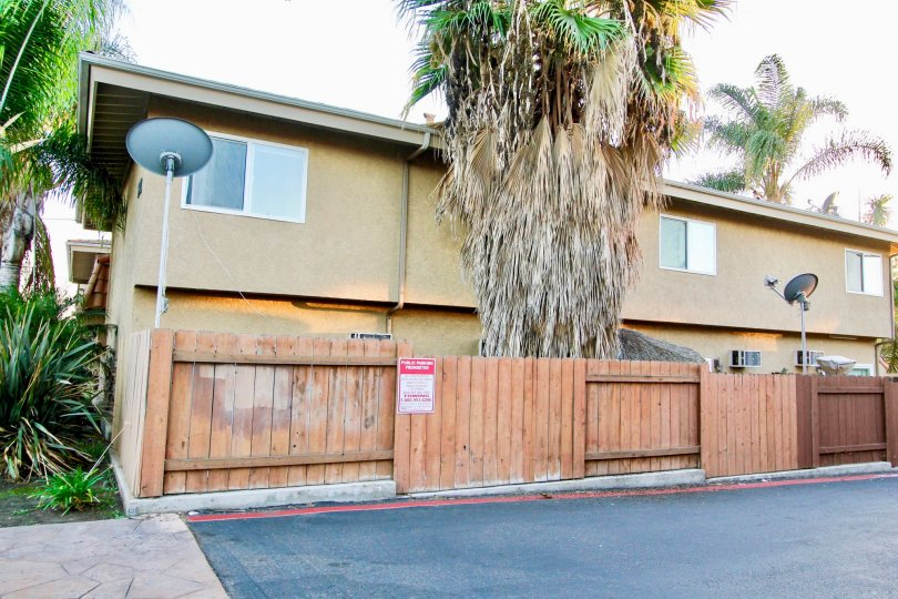 Two story apartments with wooden fence at Villa Toscano in El Cajon California