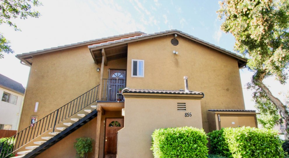 Two story housing with attached stairway at Villas at Lexington in El Cajon California