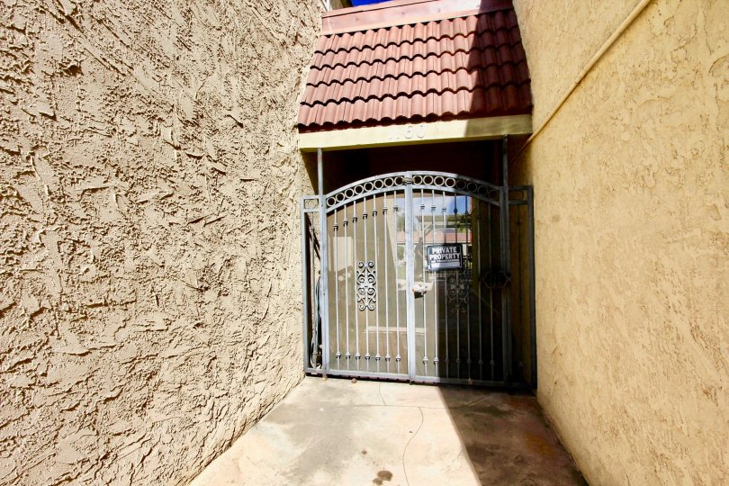 A sunny front view of the entrance gate to Washington Heights community in El Cajon, California.