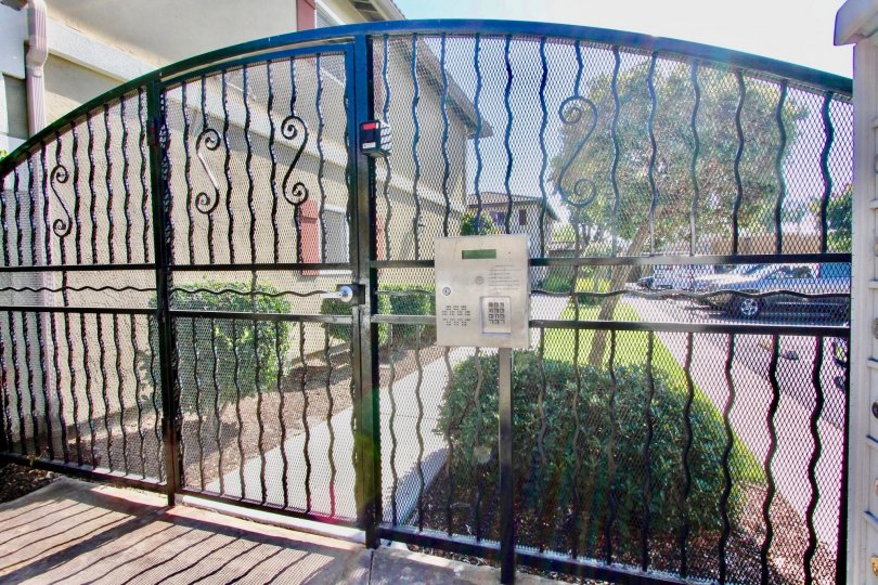 Metal security gate with keypad at Woodland Village in El Cajon California