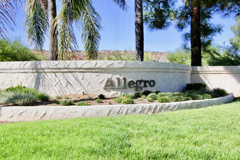Entrance sign on a white wall at Allegro in Escondido California
