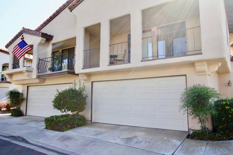 Allegro community Escondido California garage balcony sliding glass doors tile roof trees shrubs landscaping