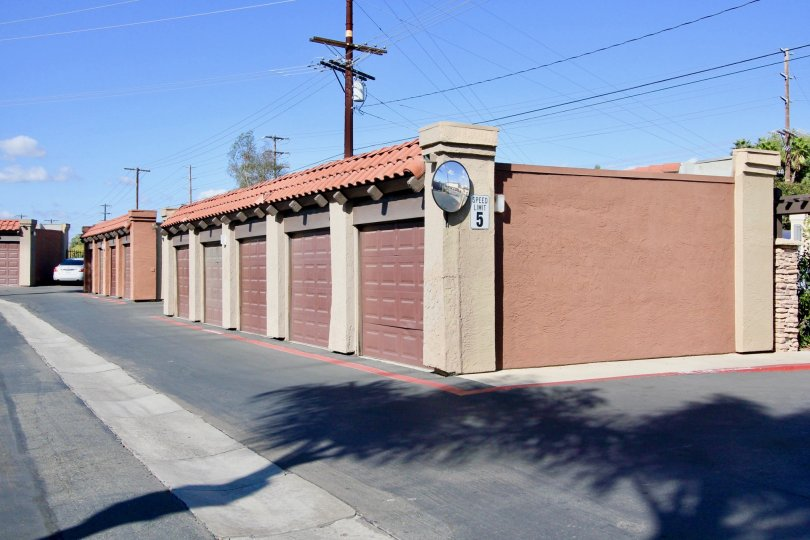 A small single story structure with pink garage doors inside Artesia located in Escondido CA
