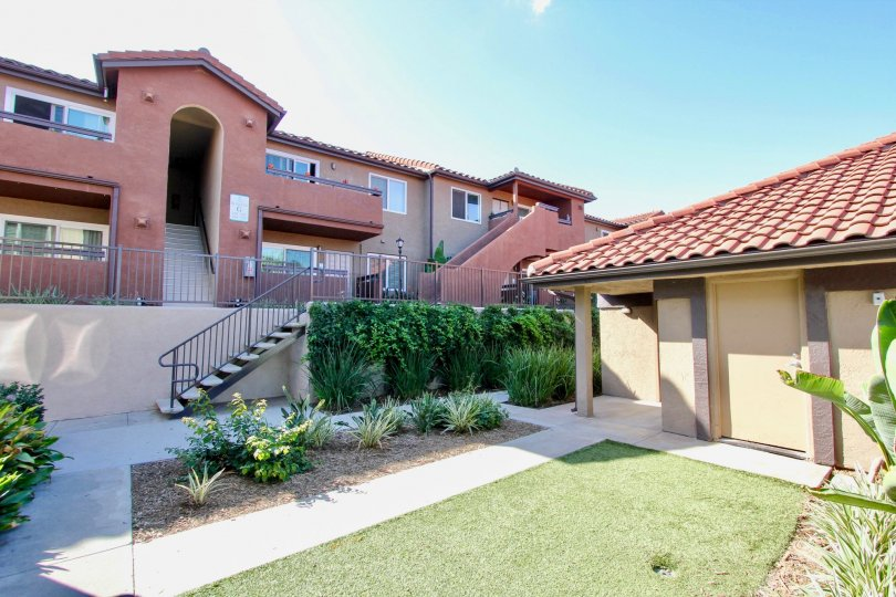 Light red unit with brush and landscaping located in Artesia of Escondido, California