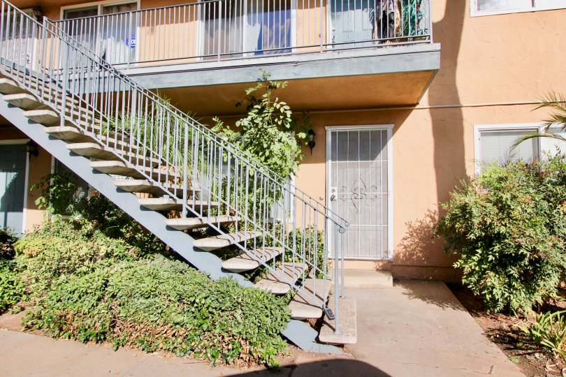 Two story residential building with stairway at Broadway Pines in Escondido Caliornia