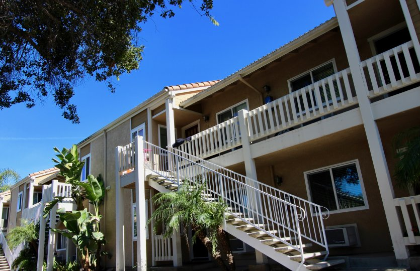 Side view of apartment building with balcony and handicap sign at Brookhaven in Escondido, Ca.