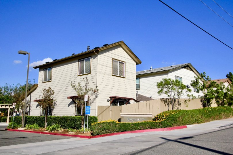 Two story townhomes with fence at Brotherton Square in Escondido California