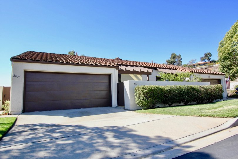 Housing with attached car garage with driveway at Cameowood in Escondido California