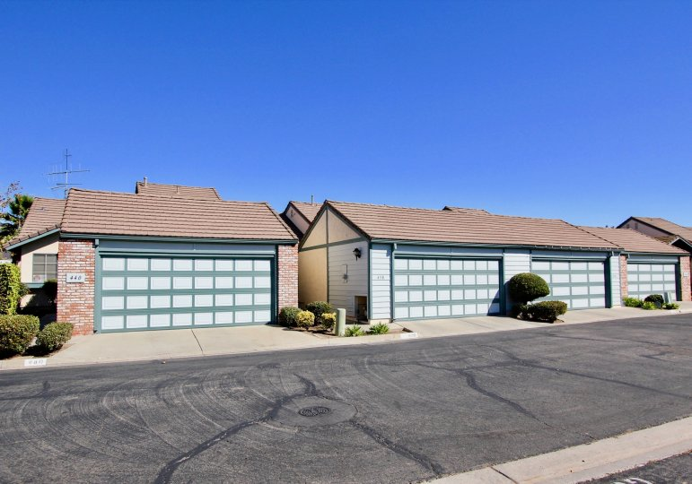 Two garage structures along a driveway located at Cape Concord in Escondido CA