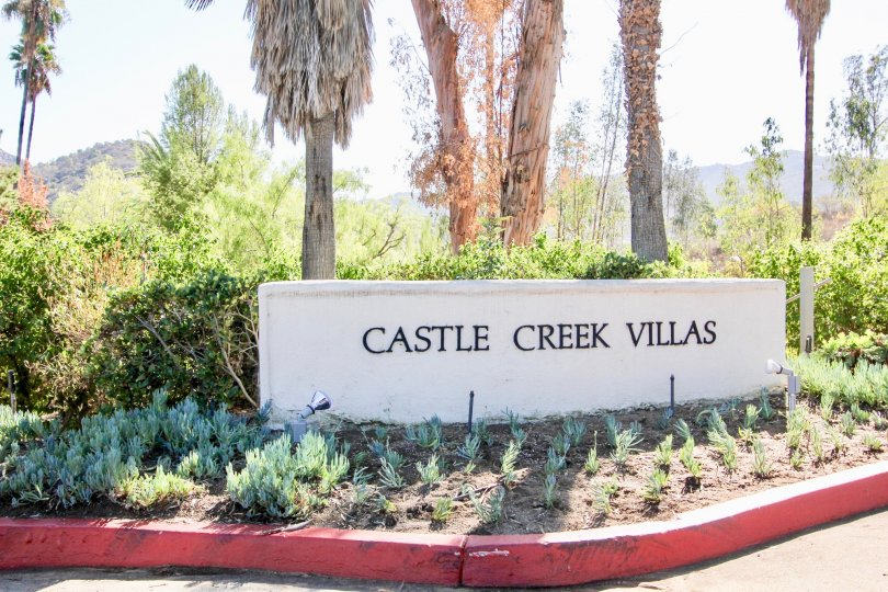 Community sign near entrance at Castle Creek Villas in Escondido California