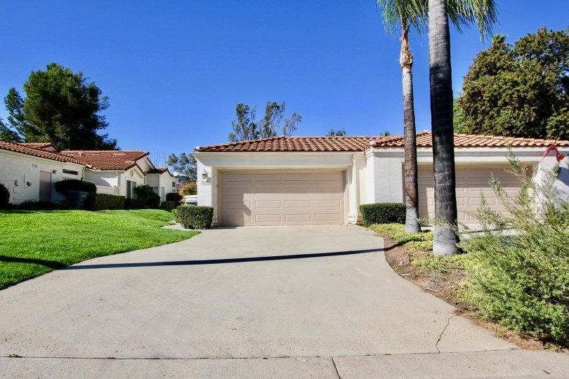 Long driveway leading up to parking garages at Castle Creek Villas in Escondido California