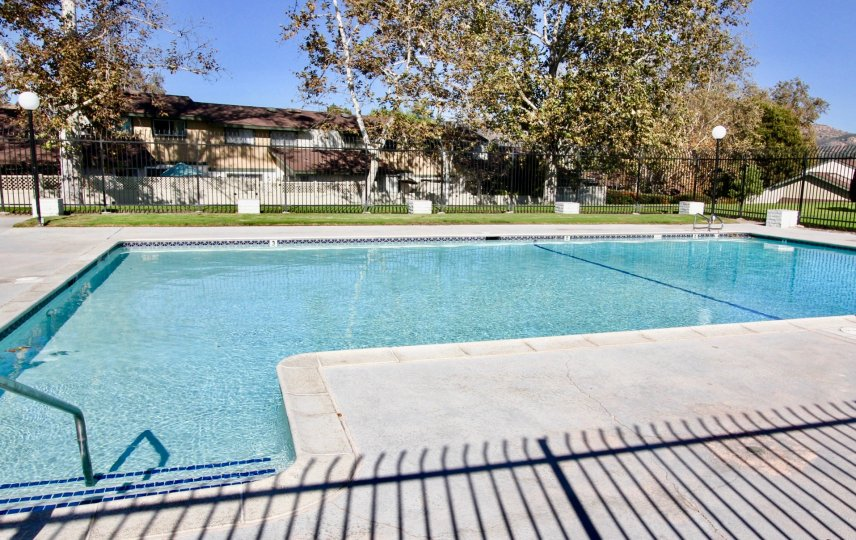 Large swimming pool surrounded by gate at Escondido Hills in Escondido California