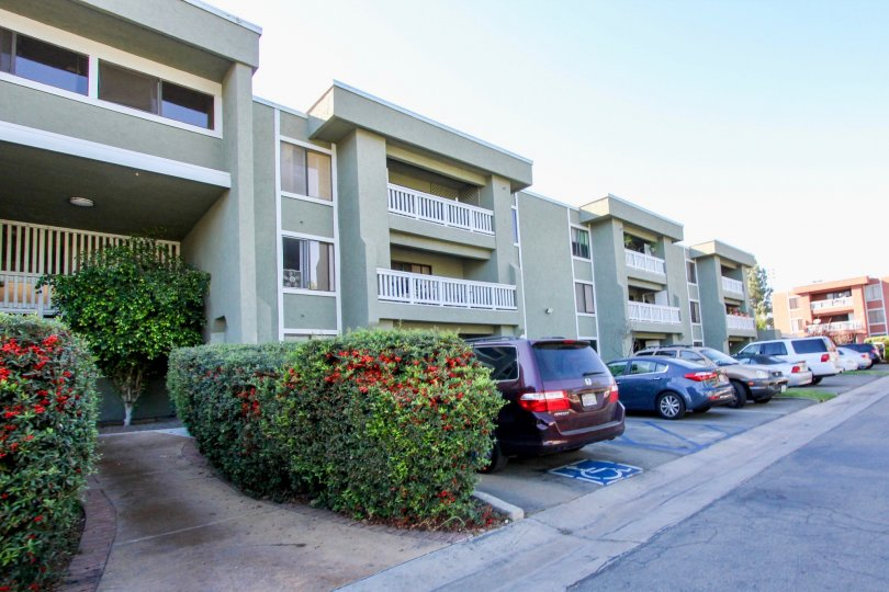 Parking in front of three story residential buildings at Escondido Village in Escondido California