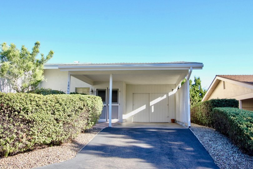 Carport, garage, driveway and entrance for single level home in Fairway Park. Located in Escondido California.