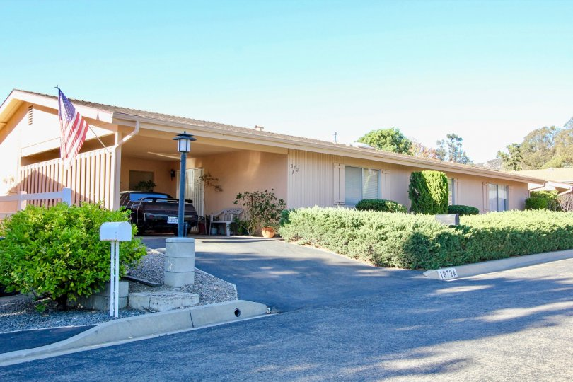 Large home with driveway and green plants at Fairway Park in Escondido California