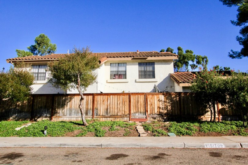 Street View of 2-story home with wooden fence in Felicita Villas in Escondido, California
