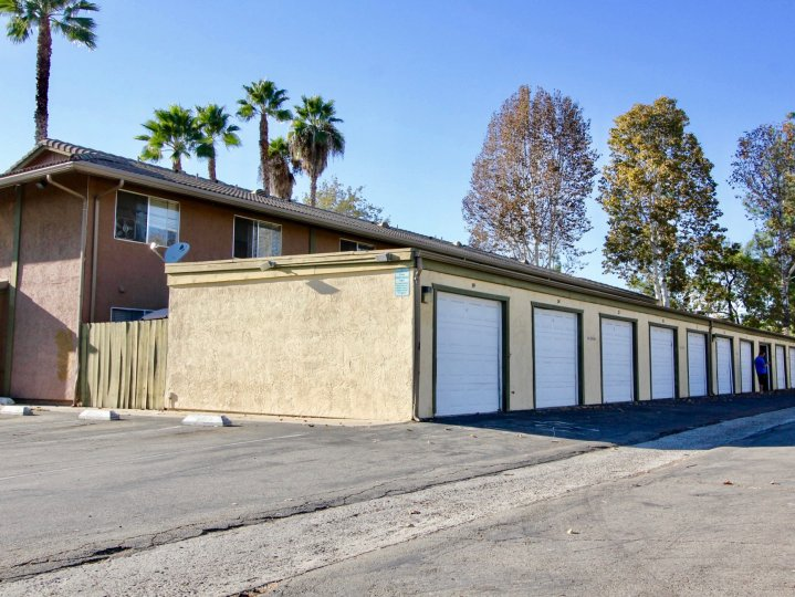 Alleyway lined with parking garages at Grand Tree Park in Escondido California