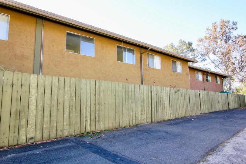 Two story residential units with fence at Grand Tree Park in Escondido California